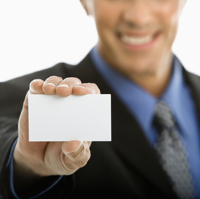 Business card etiquette image design consulting man holding business card reheart Images